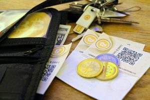 bitcoin-paper-coin-and-USB-wallets-blockchainappfactory